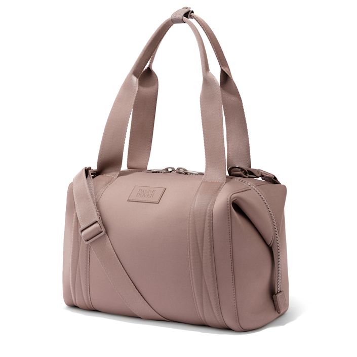 """<strong><h3>Dagne Dover Landon Carryall</h3></strong><br>A more compact duffle than most, Dagne Dover's Landon Carryall boasts multiple interior compartments and an expandable design that's ideal for travelers looking to streamline a strict, yet all-encompassing packing list.<br><br><em>Shop </em><strong><em><a href=""""https://www.dagnedover.com"""" rel=""""nofollow noopener"""" target=""""_blank"""" data-ylk=""""slk:Dagne Dover"""" class=""""link rapid-noclick-resp"""">Dagne Dover</a></em></strong><br><br><strong>Dagne Dover</strong> Landon Carryall Bag, $, available at <a href=""""https://go.skimresources.com/?id=30283X879131&url=https%3A%2F%2Fwww.dagnedover.com%2Fcollections%2Fthe-landon-carryall%23Onyx-Medium"""" rel=""""nofollow noopener"""" target=""""_blank"""" data-ylk=""""slk:Dagne Dover"""" class=""""link rapid-noclick-resp"""">Dagne Dover</a>"""