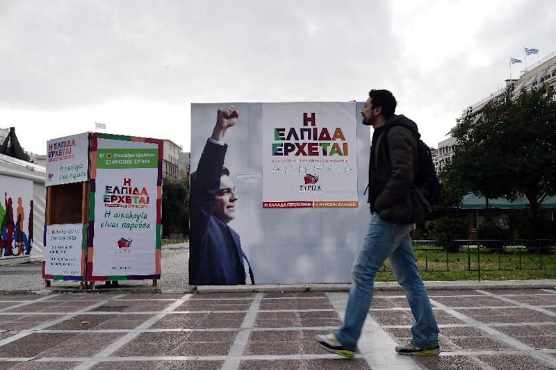 A man walks past pre-election poster bearing a picture of Alexis Tsipras, the head of the Syriza coalition and a slogan 'hope is coming' in central Athens on January 19, 2015 (AFP Photo/Louisa Gouliamaki)