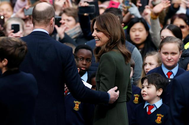 William reached out to touch Kate's arm during a walkabout. (Reuters)