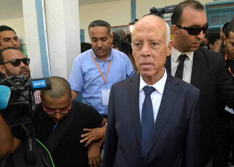 Tunisia's Kais Saied, an austere academic, is said to have won a landslide victory in the second round of the presidential elections (AFP Photo/FETHI BELAID)