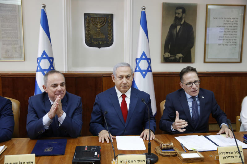 Israeli Prime Minister Benjamin Netanyahu, center, Government Secretary Tzahi Braverman, center right, Yuval Steinitz Israel's Minister of Energy, center left, in charge of Israel Atomic Energy Commission attend the weekly cabinet meeting at the prime minister's office in Jerusalem, Sunday, Nov. 18, 2018. (Abir Sultan/Pool via AP)