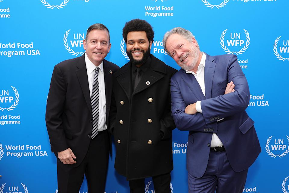 WEST HOLLYWOOD, CALIFORNIA – OCTOBER 07: (L-R) WFP USA CEO Barron Segar, The Weeknd, and U.N. WFP Executive Director David Beasley attend the U.N. World Food Programme as it welcomes The Weeknd as a Goodwill Ambassador on October 07, 2021 in West Hollywood, California. (Photo by Rich Fury/Getty Images for U.N. World Food Programme) - Credit: Getty Images for U.N. World Food Programme
