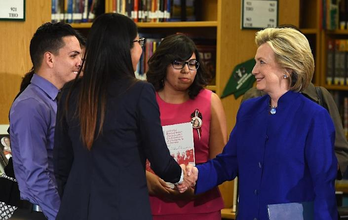 Democratic presidential candidate Hillary Clinton (R) shakes hands with students at Rancho High School on May 5, 2015 in Las Vegas, Nevada (AFP Photo/Ethan Miller)