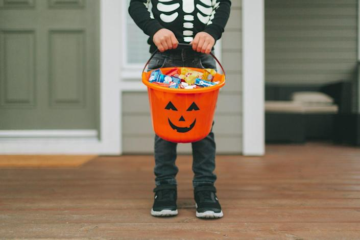 """<p>During the Celtic festival of Samhain, it was customary for poor children to go door-to-door begging for food and money. Business Insider explains that <a href=""""https://www.businessinsider.com/trick-or-treating-halloween-history-2019-10#the-first-trick-or-treaters-were-poor-children-in-medieval-europe-who-would-go-door-to-door-begging-for-food-and-money-during-the-celtic-holiday-samhain-celebrated-on-october-31-in-exchange-they-would-offer-to-pray-for-the-souls-of-their-neighbors-recently-departed-loved-ones-1"""" rel=""""nofollow noopener"""" target=""""_blank"""" data-ylk=""""slk:in exchange for their generosity, children would offer to pray for the souls"""" class=""""link rapid-noclick-resp"""">in exchange for their generosity, children would offer to pray for the souls</a> of their recently lost loved ones, hence how this activity got the name """"souling.""""</p>"""