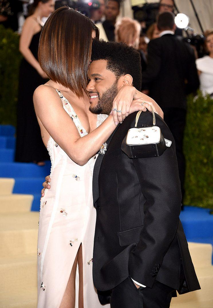 The Weeknd and Selena Gomez cuddled at the Met Gala. (Photo: Kevin Mazur/WireImage)