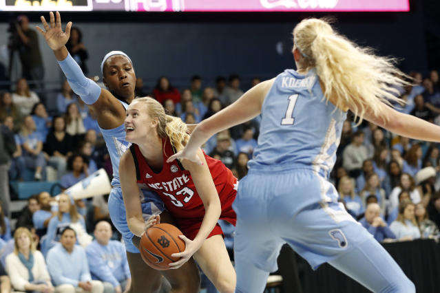 North Carolina center Janelle Bailey, left, and guard Taylor Koenen (1) guard against North Carolina State center Elissa Cunane (33) during the first half of an NCAA college basketball game in Chapel Hill, N.C., Thursday, Jan. 9, 2020. (AP Photo/Gerry Broome)