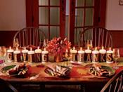"""<p>Spelled out on both the front and back of these candles, this tablescape can be enjoyed from both sides of the table. Light the slow-burning candles just before guests come into the room. Felt for crafting comes in both wool and synthetic fibers. Wool will yield more natural-looking hues. For the bands and letters, use a light- or medium-weight felt. For the runner and leaves, a heavier weight is nice. To create the candle bands from wool felt, cut bands slightly narrower than each candle's length. Cut two of each letter for the """"Giving Thanks"""" display. Secure one letter to each side of the band with spray adhesive.</p><p><a class=""""link rapid-noclick-resp"""" href=""""https://www.amazon.com/Stonebriar-Unscented-Lanterns-Hurricanes-Centerpieces/dp/B075X3CCGW/ref=sr_1_1_sspa?tag=syn-yahoo-20&ascsubtag=%5Bartid%7C10050.g.1371%5Bsrc%7Cyahoo-us"""" rel=""""nofollow noopener"""" target=""""_blank"""" data-ylk=""""slk:SHOP CANDLES"""">SHOP CANDLES</a> </p>"""