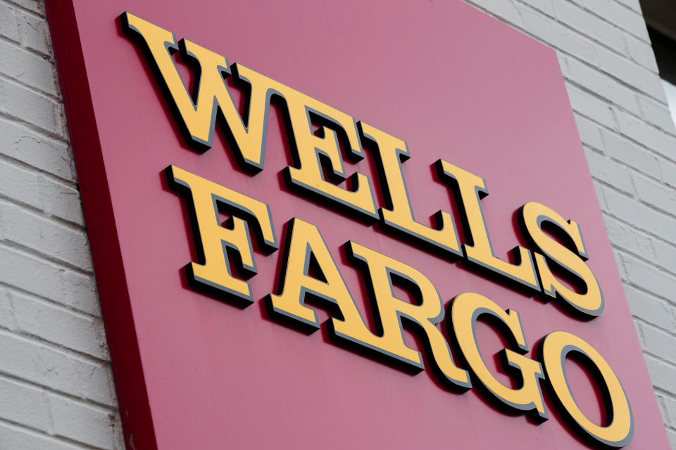 FILE – This Aug. 11, 2017, file photo shows a sign at a Wells Fargo bank location in Philadelphia. The New York Times and other news outlets are reporting Thursday, April 19, 2018, that federal regulators plan to fine Wells Fargo as much as $1 billion as early as Friday for abuses tied to its auto lending and mortgage businesses. (AP Photo/Matt Rourke, File)