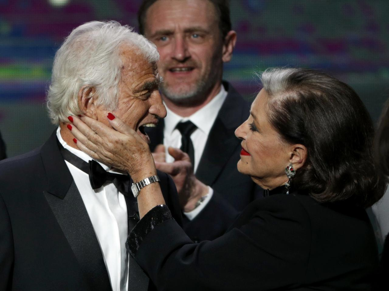 Actress Francoise Fabian congratulates actor Jean-Paul Belmondo (L) on stage as he receives an Honorary Cesar Award at the 42nd Cesar Awards ceremony in Paris, France, February 24, 2017.       REUTERS/Philippe Wojazer