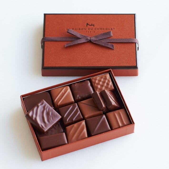"""<p><strong>La Maison du Chocolat </strong></p><p>williams-sonoma.com</p><p><strong>$32.95</strong></p><p><a href=""""https://go.redirectingat.com?id=74968X1596630&url=https%3A%2F%2Fwww.williams-sonoma.com%2Fproducts%2Fla-maison-du-chocolat-cut-chocolates&sref=https%3A%2F%2Fwww.redbookmag.com%2Ffood-recipes%2Fg35014712%2Fbest-boxed-chocolates%2F"""" rel=""""nofollow noopener"""" target=""""_blank"""" data-ylk=""""slk:Shop Now"""" class=""""link rapid-noclick-resp"""">Shop Now</a></p><p>A box from this lauded Paris shop is like a compact French vacation. Filled with milk and dark chocolate pralines and ganaches in some of their signature flavors, this is a box no francophile could resist. </p><p><strong>More: </strong><a href=""""https://www.townandcountrymag.com/style/home-decor/g33933277/cozy-gifts/"""" rel=""""nofollow noopener"""" target=""""_blank"""" data-ylk=""""slk:21 Cozy Gifts Ideas for the Homebody in Your Life"""" class=""""link rapid-noclick-resp"""">21 Cozy Gifts Ideas for the Homebody in Your Life</a></p>"""