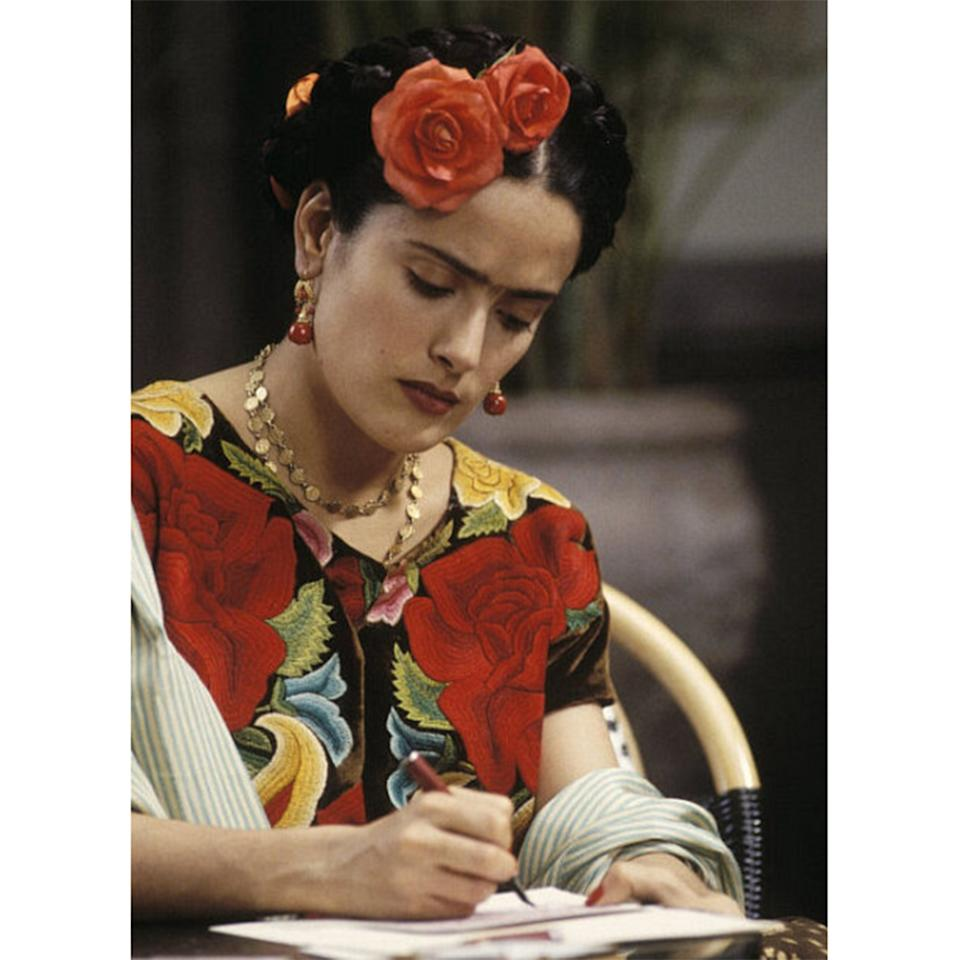 """<p>In the 1930s-40s, Frida Kahlo was one of Mexico's most well-known painters, a feminist, a political activist, and a devoted red lipstick wearer. Her signature look has been captured in the dozens of self-portraits she left behind—center-parted braids woven with flowers and ribbons, a dusky mustache and unibrow, and bright, bold lips—and she was known to sign her letters with lipstick kisses. (<a rel=""""nofollow"""" href=""""http://www.allure.com/gallery/salma-hayek-interview?mbid=synd_yahoobeauty"""">Salma Hayek</a> portrayed her onscreen in <em>Frida</em>, 2002.)</p>"""