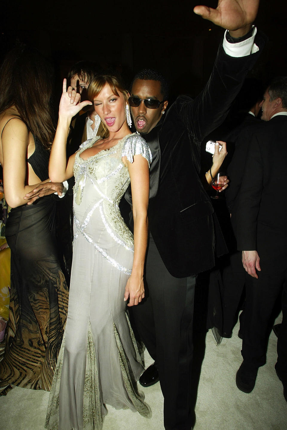 <p>Tracing back to the Met Gala with P. Diddy in 2003, it seems like Gisele's pose, in one form or another, has been with her through it all. (Photo: Getty Images) </p>