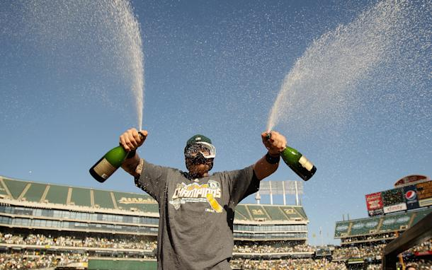 Jonny Gomes celebrates the A's AL West championship. (Getty)