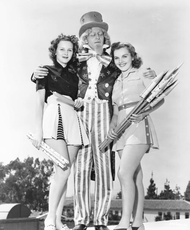 <p>Costumed actors promote Fourth of July celebrations as they pose with fireworks, Chicago, circa 1940. (Photo: Transcendental Graphics/Getty Images) </p>