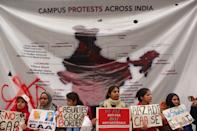 Students and local residents hold placards and raise slogans as they take part in a protest against the Citizenship Amandment Act (CAA) and National Register of Citizens (NRC), at Jamia Millia Islamia University, on December 19, 2019 in New Delhi, India. (Photo by Mayank Makhija/NurPhoto via Getty Images)