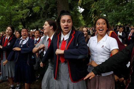 FILE PHOTO: Students perform the Haka as they gather in a vigil to commemorate victims of Friday's shooting, outside Masjid Al Noor mosque in Christchurch, New Zealand March 18, 2019. REUTERS/Jorge Silva/File Photo