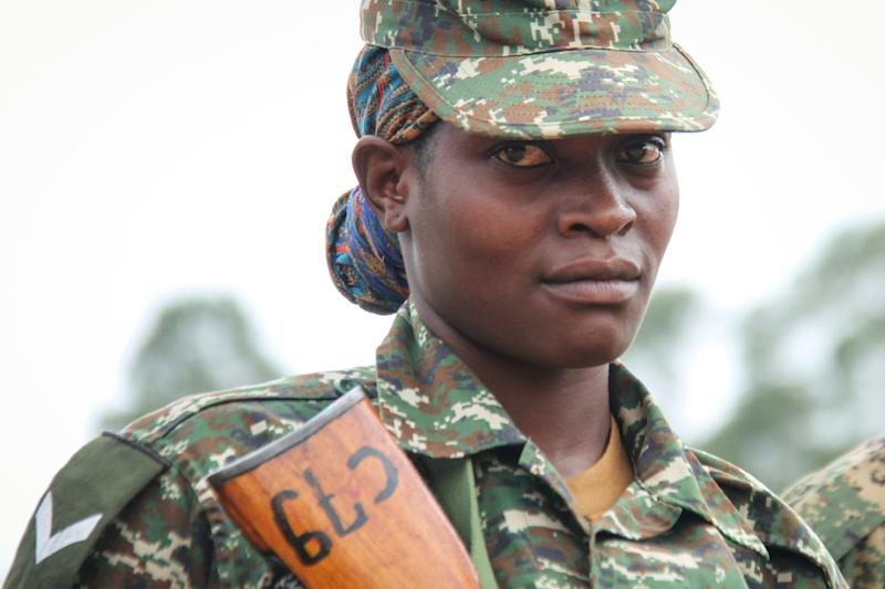 A female Soldier of the Uganda People's Defense Force (UPDF) attends a special event in Uganda in April before her contingent started its service with the UN-backed African Union Mission in Somalia (AMISOM)