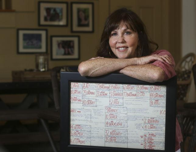 Gayle Sierens poses with her spotting chart from her NFL play-by-play debut in 1987. (AP)