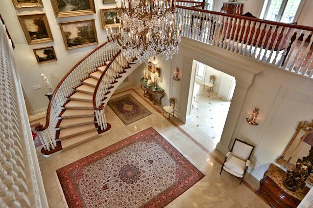 "<p>This stately home has a classic Versailles style, with a central hall, formal dining room, tennis court with night lighting and sauna. (<a href=""http://www.68thebridlepath.com/"" rel=""nofollow noopener"" target=""_blank"" data-ylk=""slk:Barry Cohen Homes"" class=""link rapid-noclick-resp"">Barry Cohen Homes</a>) </p>"