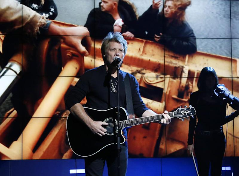 """FILE - In this Nov. 2, 2012, photo provided by NBC, Jon Bon Jovi performs in New York, during """"Hurricane Sandy: Coming Together,"""" a concert hosted by NBC to raise money for victims of Superstorm Sandy. Bon Jovi, along with Paul McCartney, Bruce Springsteen & the E Street Band, Kanye West, Billy Joel, The Who and Alicia Keys will perform at another benefit concert, on Dec. 12, at Madison Square Garden in New York. Proceeds from the concert will go to the Robin Hood Relief Fund to help those affected by Sandy in New York, New Jersey and Connecticut. Sandy's assault more than two weeks ago created widespread damage and power outages throughout the area. (AP Photo/NBC, Heidi Gutman, file)"""