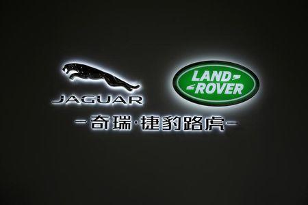 FILE PHOTO - A Jaguar Land Rover logo is seen on the building inside the Chery Jaguar Land Rover plant in Changshu