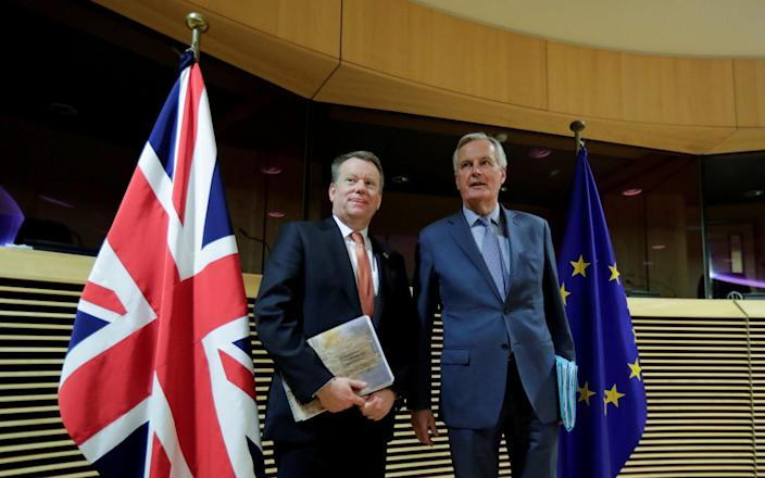 European Union chief Brexit negotiator Michel Barnier and British Prime Minister's Europe adviser David Frost 5 are seen at start of the first round of post -Brexit trade deal talks between the EU and the United Kingdom, in Brussels, Belgium March 2, 2020. - Oliver Hoslet/Pool via REUTERS/File Photo