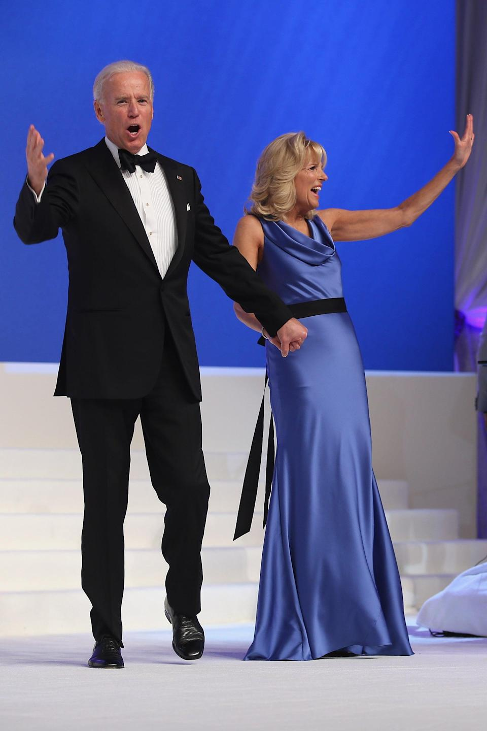 """<p>Jill chose this blue silk gown for the Inaugural Ball in 2013, completing her homage to the """"red and blue"""" colors of the US flag. The look was <a href=""""https://twitter.com/verawang/status/293564512102129664"""" class=""""link rapid-noclick-resp"""" rel=""""nofollow noopener"""" target=""""_blank"""" data-ylk=""""slk:created by American fashion designer Vera Wang"""">created by American fashion designer Vera Wang</a>, who is of Chinese descent. """"What a joy, honor and privilege to have dressed Dr Jill Biden for tonight's Inauguration. A beautiful, spirited, accomplished woman!"""" Wang famously posted on Twitter.</p>"""