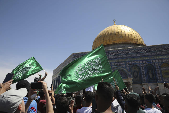 Worshippers wave Hamas flags during a protest against the likely evictions of Palestinian families from the homes, after the last Friday prayers of the Muslim holy month of Ramadan at the Dome of the Rock Mosque in the Al Aqsa Mosque compound in the Old City of Jerusalem, Jerusalem, Friday, May 7, 2021. (AP Photo/Mahmoud Illean)