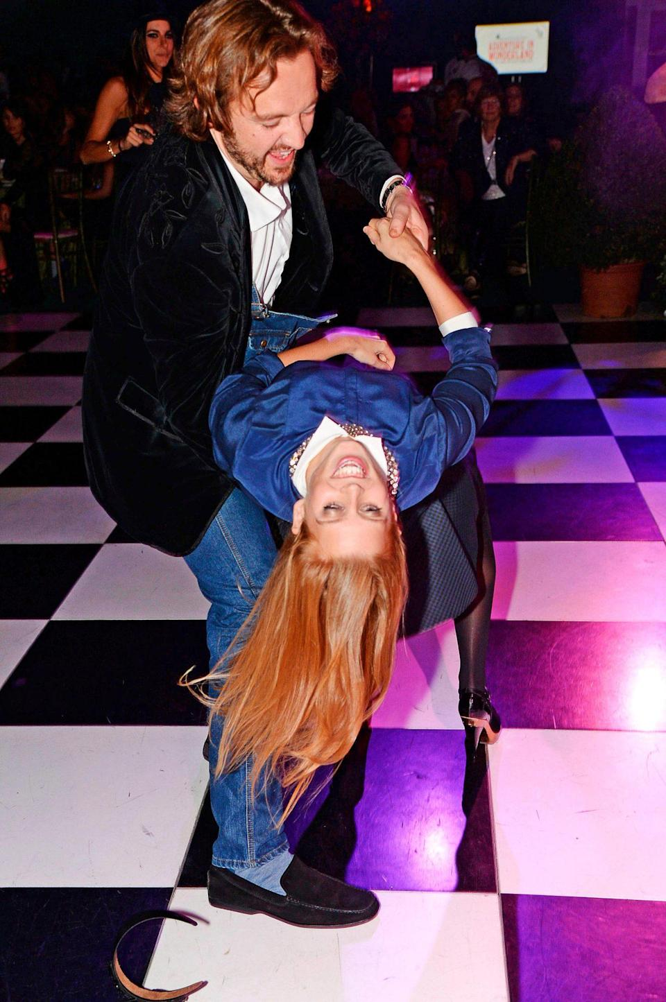 <p>Beatrice danced with a friend in London at the 2013 Adventure in Wonderland Ball, which raised funds for the Great Ormond Street Hospital Children's Charity.</p>