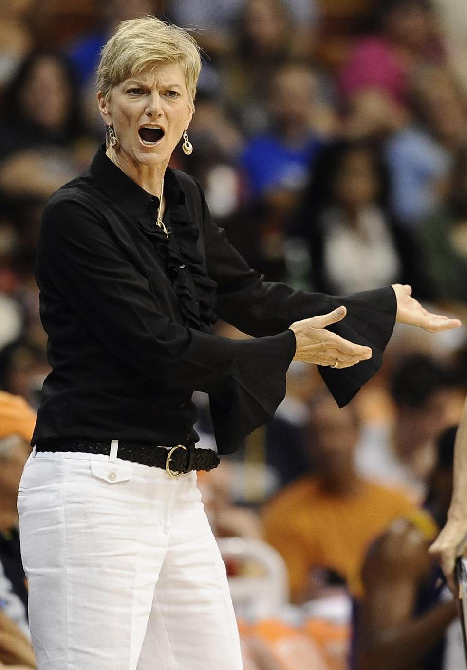 Los Angeles Sparks head coach Carol Ross reacts to a technical foul called on her during the first half of a WNBA basketball game against the Connecticut Sun in Uncasville, Conn., Tuesday, Aug. 6, 2013. (AP Photo/Jessica Hill)