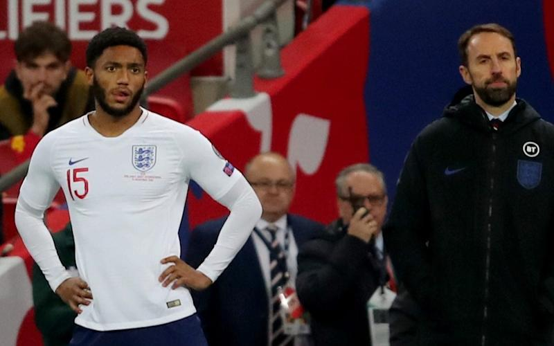 Joe Gomez (left) was forced to pull out of England's trip to Kosovo - Getty Images Europe