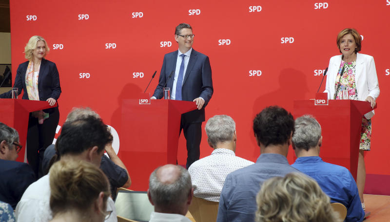 The three interim leaders of German Social Democrats, SPD, Manuela Schwesig, Thorsten Schaefer-Guembel and Malu Dreyer talk to the press in Berlin, Germany, Monday, June 24, 2019. The Social Democrats are in a poll slump and rudderless after leader Andrea Nahles quit following the party's battering in last month's European Parliament election. So far, no one has declared their candidacy for the notoriously difficult job — and the three deputy leaders who have taken the reins jointly on an interim basis have all ruled themselves out. (Wolfgang Kumm/dpa via AP)