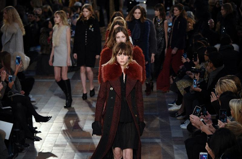 British model Edie Campbell (front) presents a creation for Sonia Rykiel at her autumn/winter ready-to-wear show in Paris in March (AFP Photo/Martin Bureau)