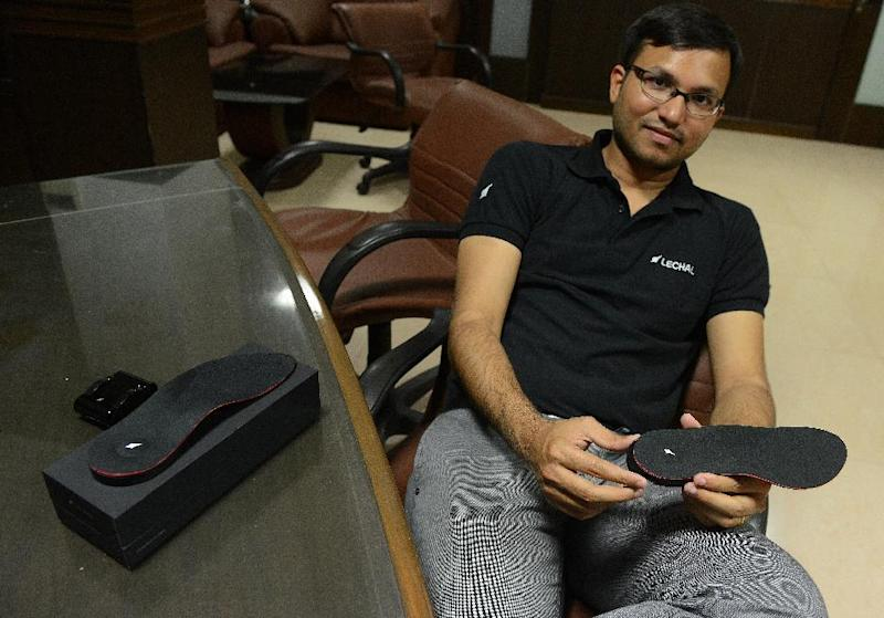 Krispian Lawrence, CEO of Ducere Technologies, holds the inner sole of a pair of GPS-enabled smart sports shoes called LeChal at his office in Hyderabad on August 11, 2014 (AFP Photo/Noah Seelam)