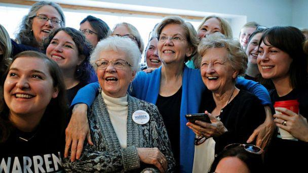 PHOTO: Sen. Elizabeth Warren poses for a group photo at a Democratic presidential campaign canvass kickoff at the home of a supporter in Urbandale, Iowa, Feb. 1, 2020. (Brian Snyder/Reuters)