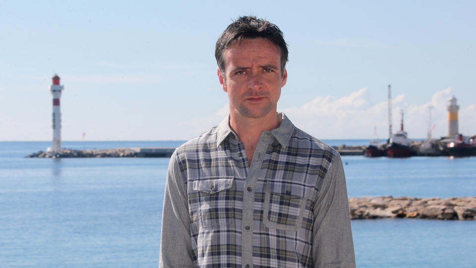 Richard Harrington poses during a photocall for 'Hinterland' at the 29th MIPCOM in Cannes on 8 October 2013. (Credit: AP Photo/Lionel Cironneau)