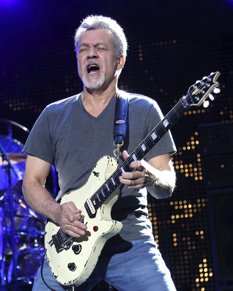 FILE - In this Aug. 13, 2015, file photo Eddie Van Halen of Van Halen performs at the Nikon at Jones Beach Theater in Wantagh, N.Y. Van Halen's Southern California hometown will memorialize the late guitar legend, but it's still unclear what form the tribute will take. The Pasadena City Council on Monday, Oct. 26, 2020, directed officials to come up with ideas and report back on how to best remember the rock icon who died of cancer Oct. 6, 2020, at age 65. (Photo by Greg Allen/Invision/AP, File)