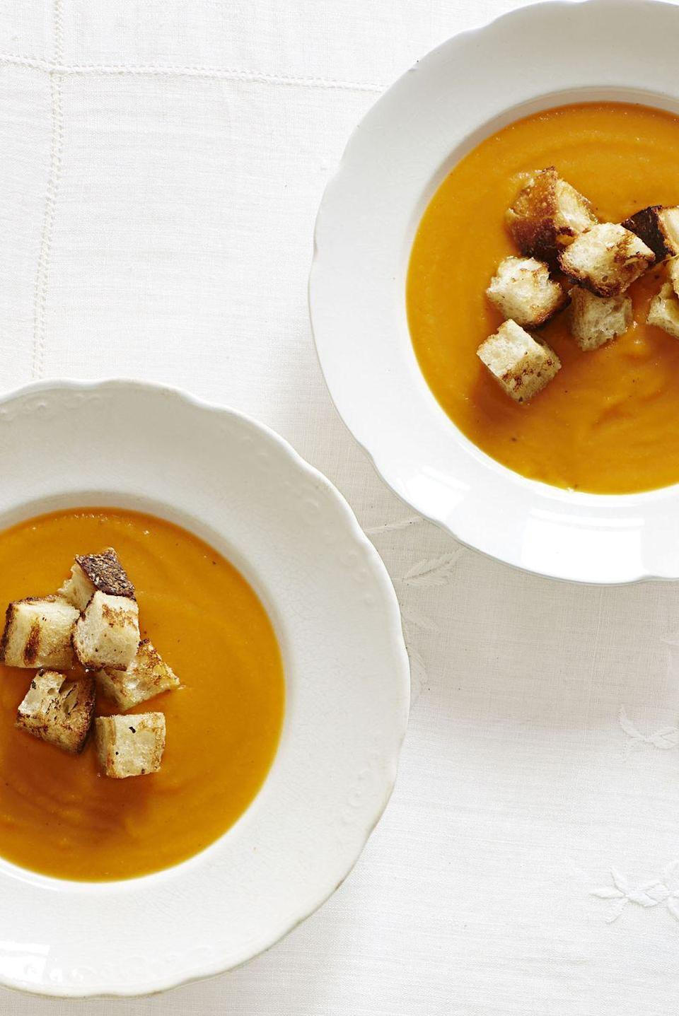 """<p>Start off your feast with this easy-to-make — and easy-to-eat — one-pot soup.</p><p><em><a href=""""https://www.goodhousekeeping.com/food-recipes/a14444/winter-squash-soup-recipe-ghk1113/"""" rel=""""nofollow noopener"""" target=""""_blank"""" data-ylk=""""slk:Get the recipe for Winter Squash Soup »"""" class=""""link rapid-noclick-resp"""">Get the recipe for Winter Squash Soup »</a></em></p><p><strong>RELATED: </strong><a href=""""https://www.goodhousekeeping.com/holidays/thanksgiving-ideas/g4734/butternut-squash-soup-recipes/"""" rel=""""nofollow noopener"""" target=""""_blank"""" data-ylk=""""slk:20 Butternut Squash Soup Recipes to Warm Up Your Thanksgiving"""" class=""""link rapid-noclick-resp"""">20 Butternut Squash Soup Recipes to Warm Up Your Thanksgiving</a></p>"""