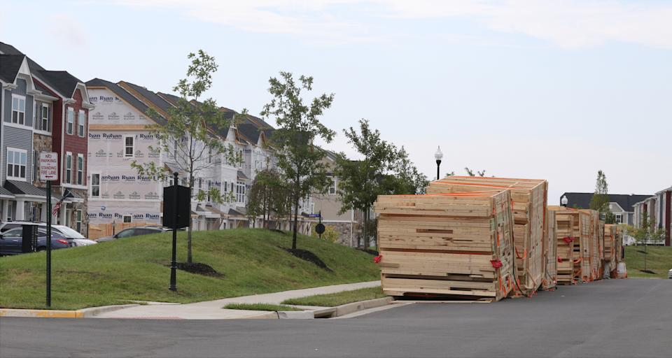 In this photo taken Sept. 18, 2016, pallets of pre-fabricated sections of new townhouses await assembly in the South Riding section of Aldie in Loudoun County, Va. New housing construction has soared in the Washington suburbs in recent years. Some completed units and others partially done are shown.(AP Photo/Harry Hamburg)