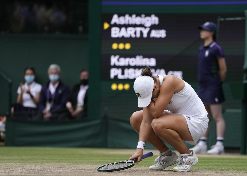 Australia's Ashleigh Barty reacts after defeating the Czech Republic's Karolina Pliskova in the women's singles final on day twelve of the Wimbledon Tennis Championships in London, Saturday, July 10, 2021. (AP Photo/Kirsty Wigglesworth)