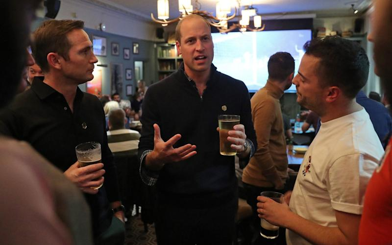 The Duke of Cambridge watches the football with football fans and Chelsea manager Frank Lampard, after discussing mental health as part of the Heads Up campaign - PA