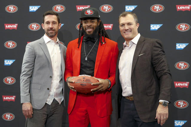 He's a Niner now: Cornerback Richard Sherman, center, and San Francisco CEO Jed York, not pictured, had blocked each other on Twitter when they were NFL rivals. (AP)