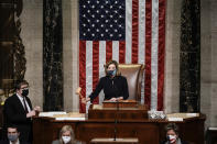 Speaker of the House Nancy Pelosi, D-Calif., gavels in the final vote of the impeachment of President Donald Trump, for his role in inciting an angry mob to storm the Congress last week, at the Capitol in Washington, Wednesday, Jan. 13, 2021. (AP Photo/J. Scott Applewhite)