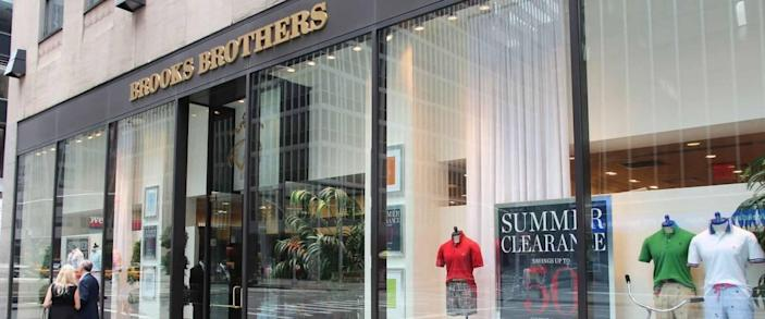 NEW YORK, USA - JULY 4, 2013: People walk by Brooks Brothers fashion store in 6th Avenue, New York. Brooks Brothers is one of oldest clothes store chains in the USA, founded in year 1818.