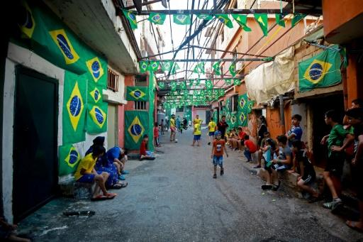 Lebanese children play football in a street filled with Brazilian flags in the Ersal district, southern Beirut, on July 6, 2018