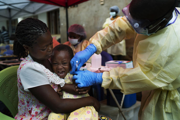 FILE - In this Saturday, July 13, 2019 file photo, a child is vaccinated against Ebola in Beni, Congo. The World Health Organization and other partners said Tuesday Jan. 12, 2021, they are creating a global emergency stockpile of about 500,000 vaccines of Ebola vaccines to help stamp out any future outbreaks of the disease.(AP Photo/Jerome Delay, file)
