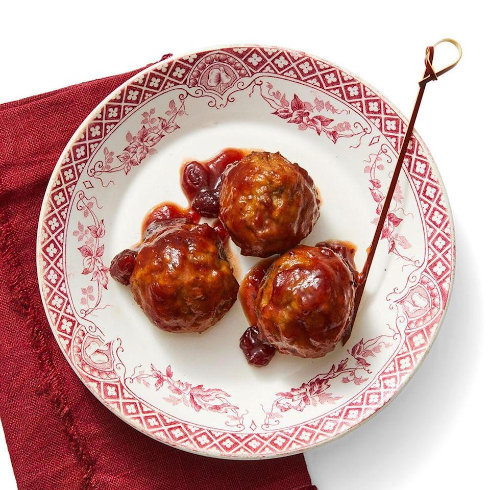 """<p>These meatballs are perfect for folks who love something that hits all the flavor notes. The saltiness of the meatballs pairs perfectly with the tangy and sweet cranberry marinade. </p><p><em><strong><a href=""""https://www.womansday.com/food-recipes/food-drinks/a29463992/tangy-cranberry-meatballs-recipe/"""" rel=""""nofollow noopener"""" target=""""_blank"""" data-ylk=""""slk:Get the Tangy Cranberry Meatballs recipe"""" class=""""link rapid-noclick-resp"""">Get the Tangy Cranberry Meatballs recipe</a>.</strong></em></p>"""
