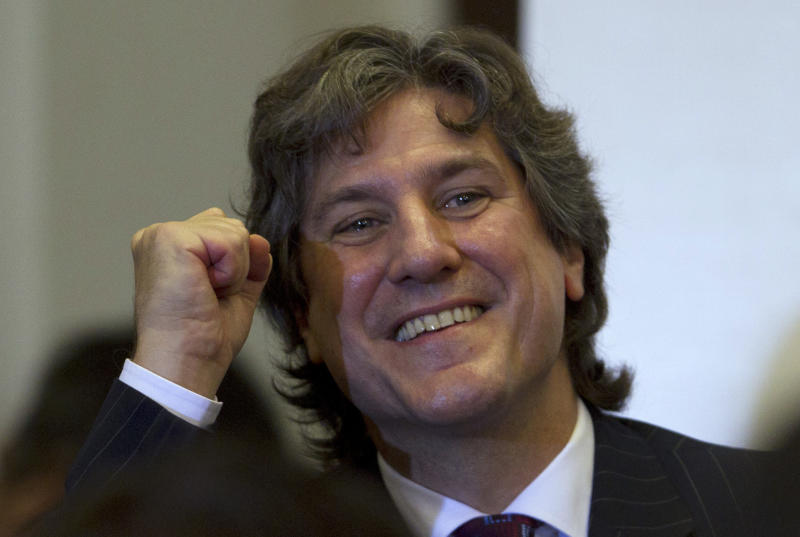 Argentina's Vice President Amado Boudou gestures as he arrives to a ceremony at which Argentina's President Cristina Fernandez signed into law the takeover of the YPF oil company in Buenos Aires, Argentina, Friday, May 4, 2012. Fernandez signed into law her expropriation of Spanish-owned Repsol's controlling stake in her country's privatized state energy company. (AP Photo/Natacha Pisarenko)