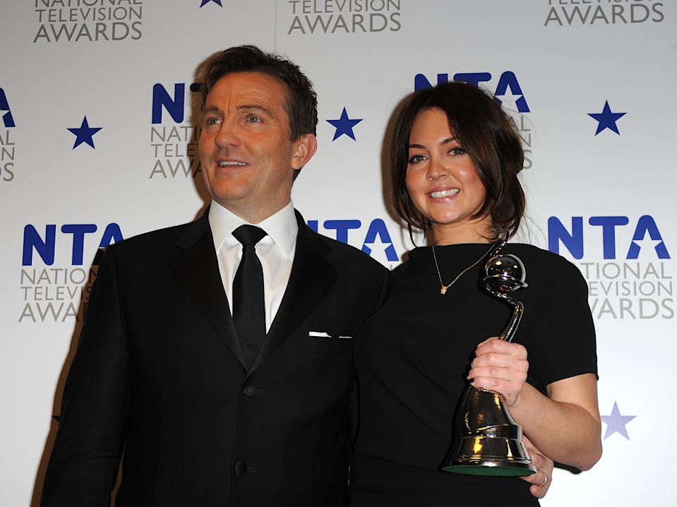 Lacey Turner with the award for Serial Drama Performance and Bradley Walsh, at the National Television Awards 2010, at the 02 Arena, London. (Photo by Zak Hussein/PA Images via Getty Images)