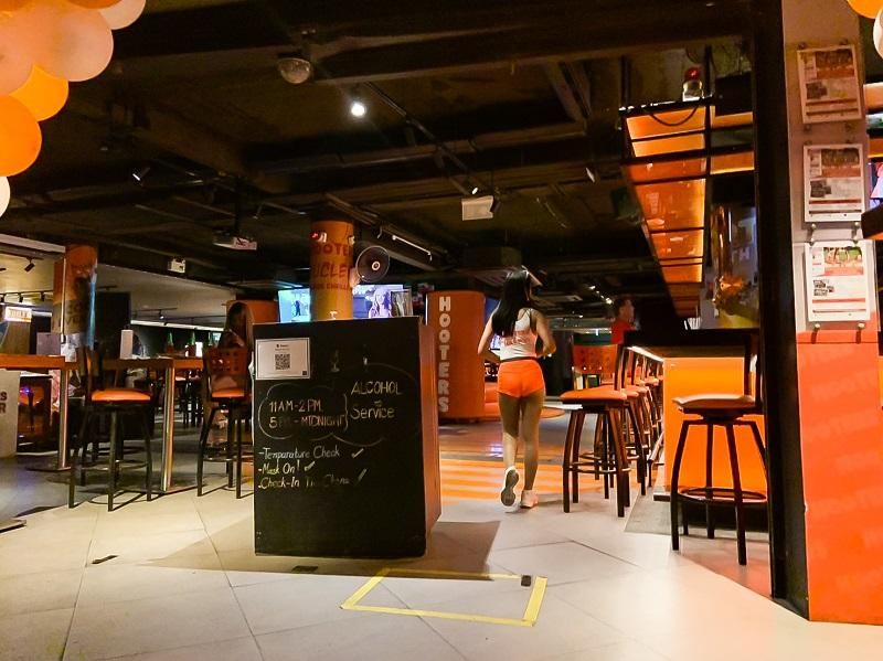 Few patrons were seated at Hooters in Soi Sukhumvit 4.